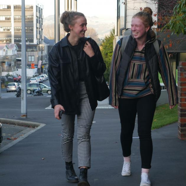 Otago Polytechnic students Nicole Ruske (20, left), of Dunedin, and Lana Evans (19), of Wellington, walk in the student quarter on their first day back on Tuesday. PHOTO: JESSICA WILSON