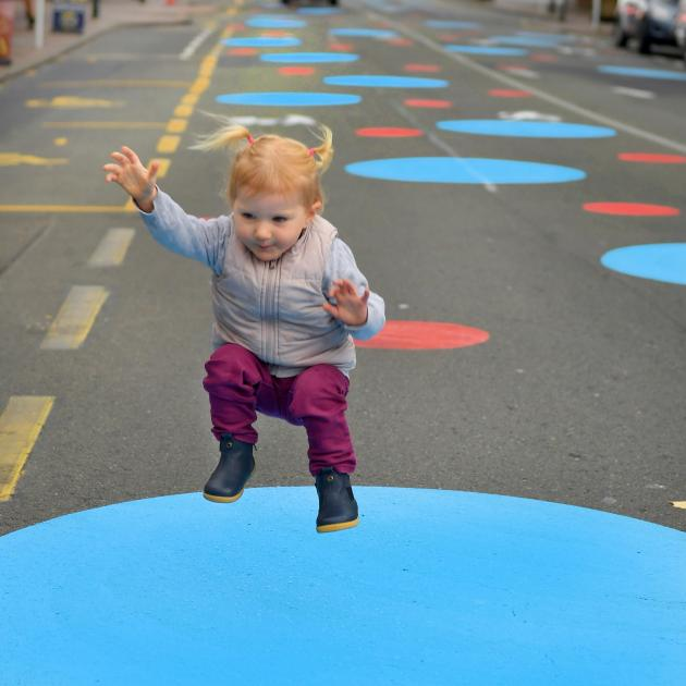 Faith Bishop (1) plays on one of the spots in George St. Her mother Caroline is concerned it...
