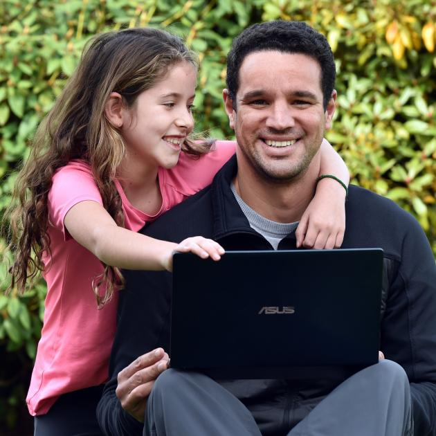 Dunedin geneticist Dr Bruno Santos, recently promoted to partner at agribusiness company AbacusBio, with his daughter, Isabela Green-Santos (8).  PHOTO: PETER MCINTOSH