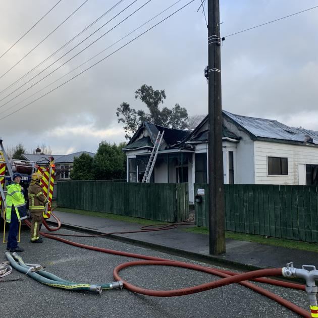 Fire crews at the scene of a house fire in Mataura today. Photo: Abbey Palmer