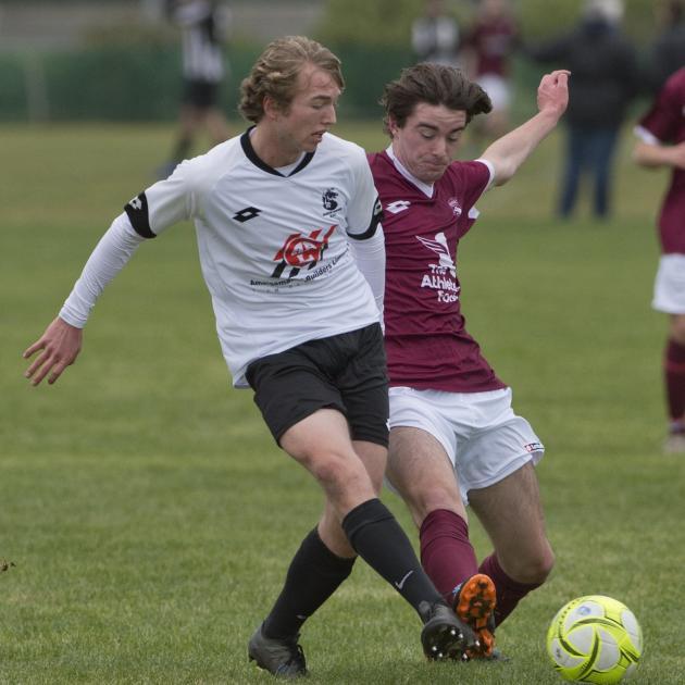 Roslyn-Wakari's Luke Williams (left) moves the ball under pressure from Dunedin Technical's Will...