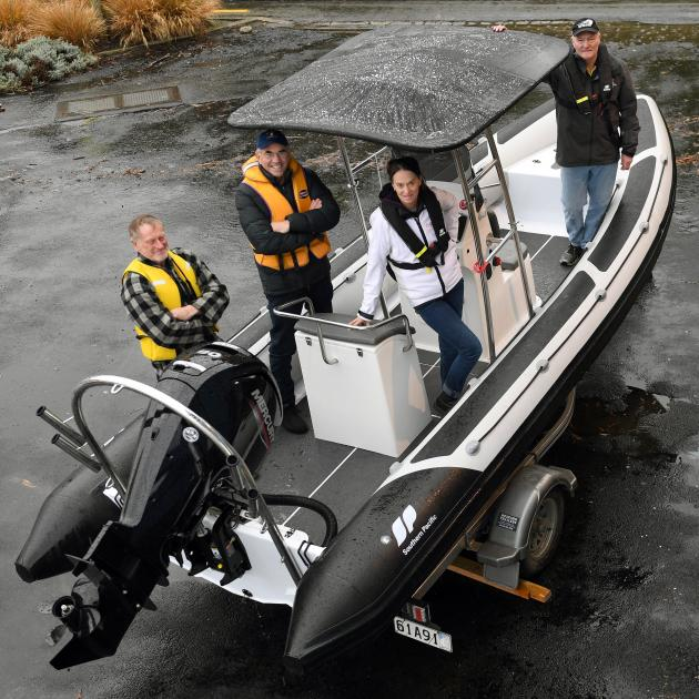 Showing off a new club rescue boat are Macandrew Bay Boating Club members (from left) club...