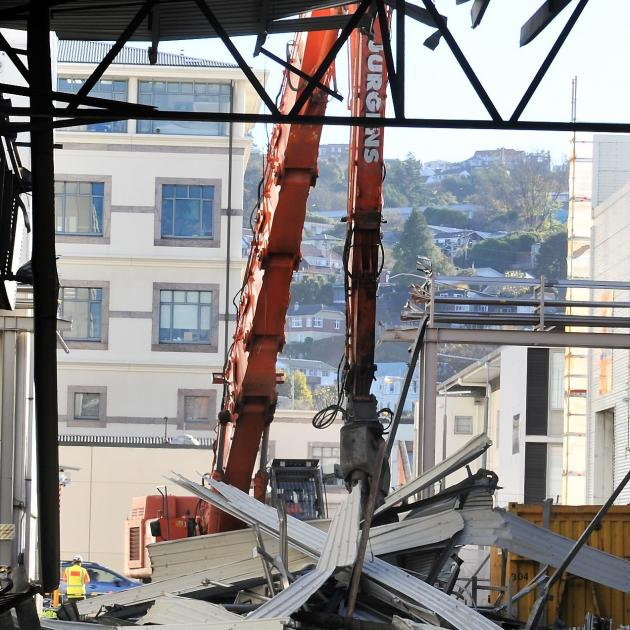 Part of the canopy of the former Cadbury warehouse is pulled down, as work begins on clearing the...