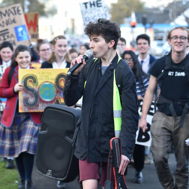 Zak Rudin leads young climate change activists as they march from the Museum Reserve to Labour MP...