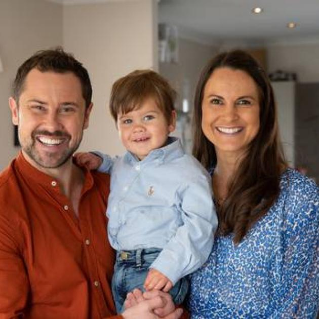 Sam Wallace and his partner Sarah Bowman with their son Brando. Photo: Sylvie Whinray / NZ Herald