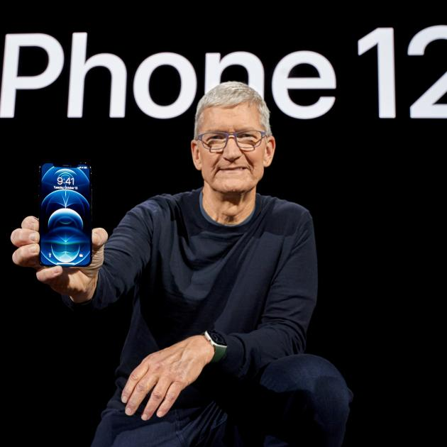 Apple CEO Tim Cook poses with the all-new iPhone 12 Pro. Photo: Brooks Kraft/Apple Inc./Handout via Reuters