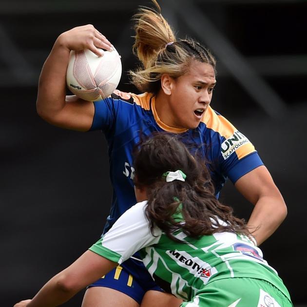Otago Spirit second five-eighth  Kilisitina Moata'ane is tackled by Manawatu lock Kahurangi...