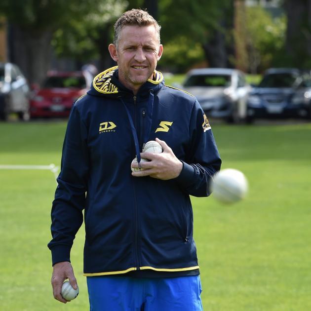 Otago Sparks coach Craig Cumming retrieves some balls during a training session at Logan Park...