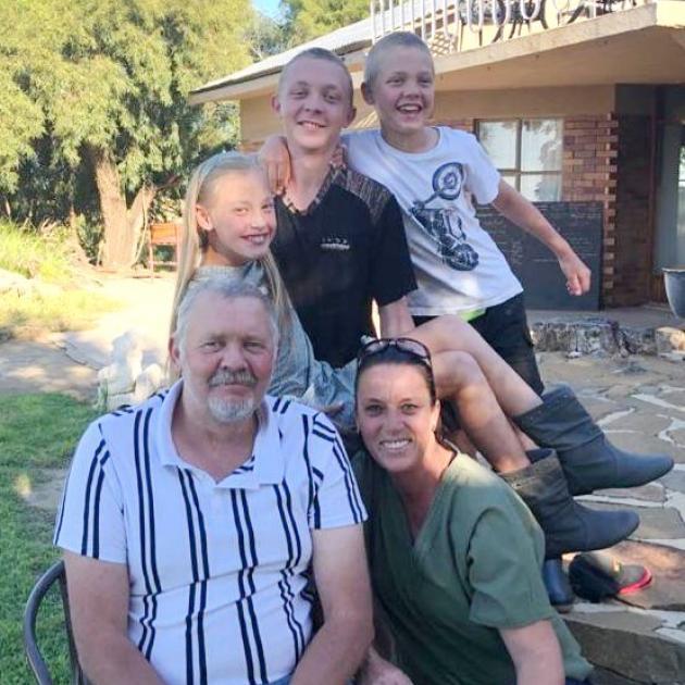 Dewald, Carla, Marieke (11), Adriaan (15) and Carlo (13) Badenhorst in South Africa, where they...