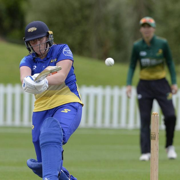 Otago Sparks captain Bella James smashes puts the ball through the legside during her side's...