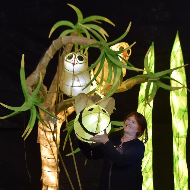 Artistic director Philipa Crofskey sets up Summer Lights, a display featuring lanterns from this...