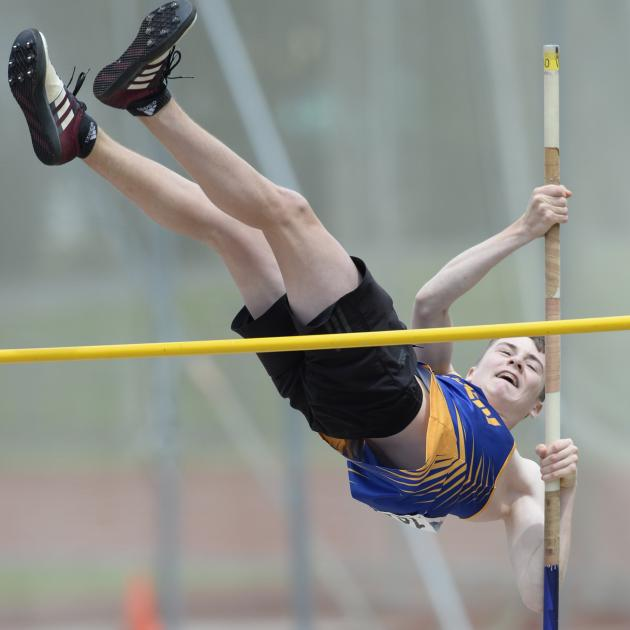 Taieri athlete Cole Gibbons clears the bar in the open pole vault at the Caledonian Ground on...