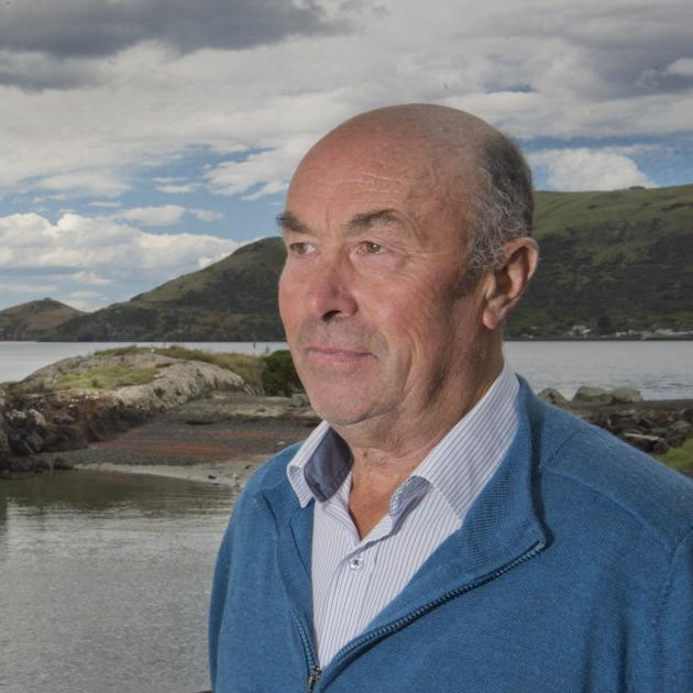 Otakou kaumatua Edward Ellison stands at Wellers Rock on the Otago Peninsula, which is named...