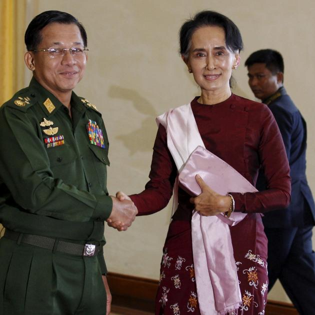 Commander-in-Chief Min Aung Hlaing with National League for Democracy party leader Aung San Suu...