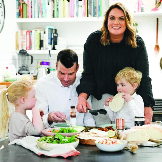 Keepers author Cherie Metcalfe relaxes in the kitchen with her family. PHOTOS: MELANIE JENKINS