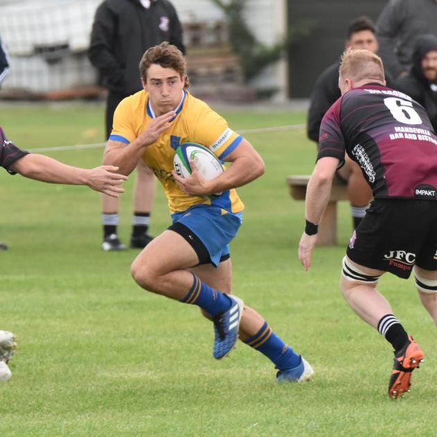 Josh McKay eyes a gap against Ohoka during his senior rugby debut for Kaiapoi. Photo: Shane...