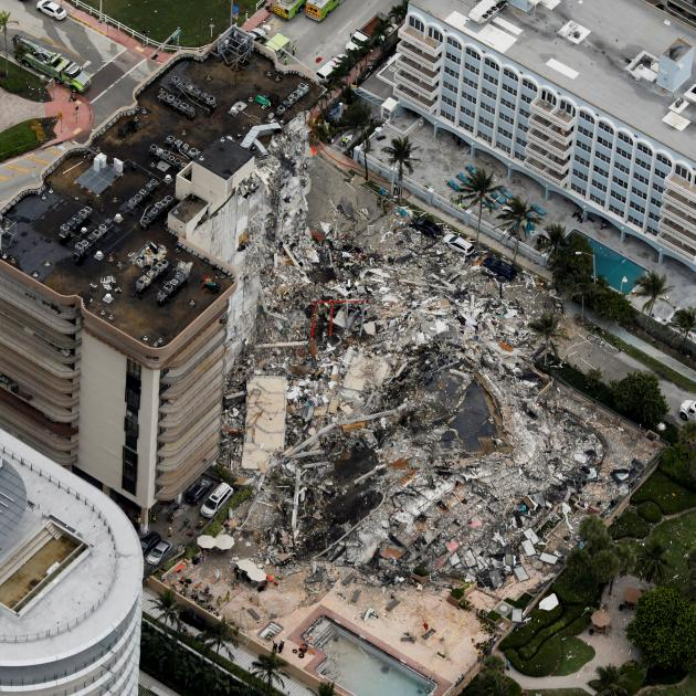 An aerial view showing a partially collapsed building in Surfside near Miami Beach. Photo: Reuters