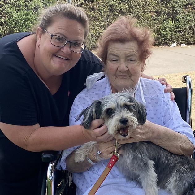 Kim Kennedy and her late mother Patricia Robinson, holding her dog Furby earlier this year....