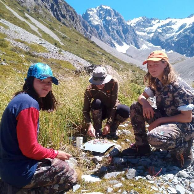 Ella Higgins and her sister make some tahr capriccio while waiting for the helicopter to pick...