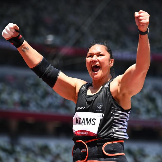 A delighted Valerie Adams celebrates her bronze medal. Photo: Reuters
