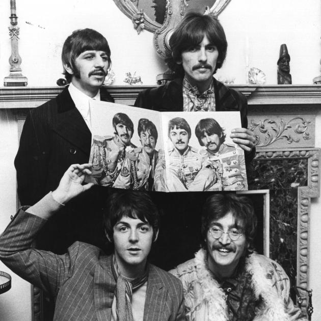 The Beatles, with John Lennon in his Afghan coat, launch Sgt. Pepper's. PHOTO: GETTY IMAGES