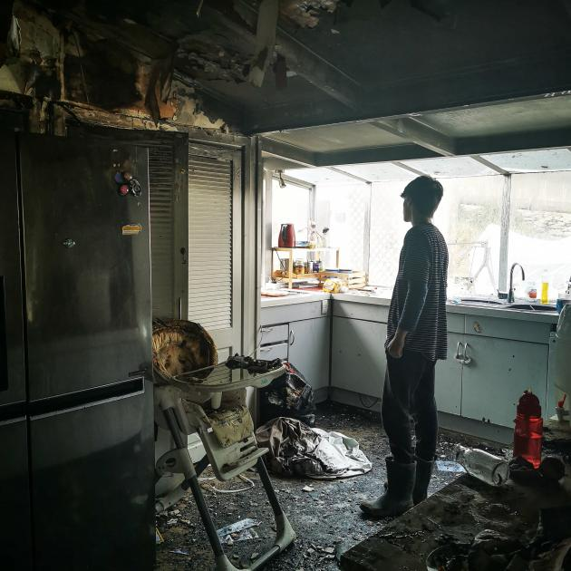 Tanner (16) surveys the damage to his families home after it was destroyed by fire last week. Photo: Supplied