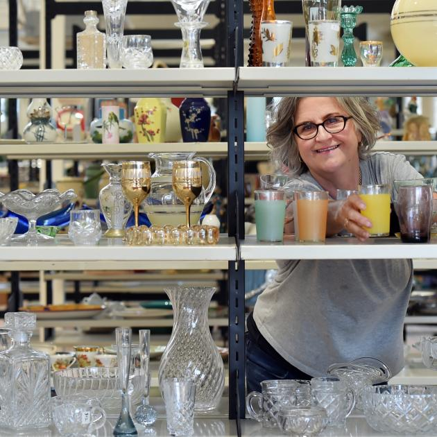 Otago Community Hospice retail development manager Cat Callanan sets up the new Hospice Shop in...