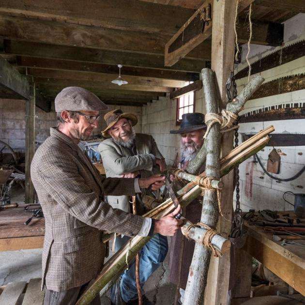 Hard at work in the granary at Totara Estate. PHOTO: GRANT SHEEHAN FOR HERITAGE NEW ZEALAND