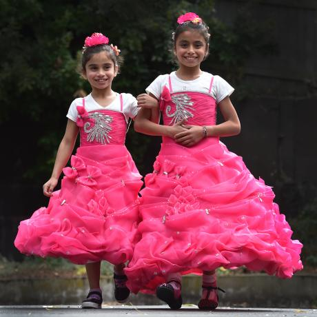 Former Syrian refugees Narjes (8) and Ayat (10) Jamal dressed up for a welcoming ceremony for new settlers at the Dunedin Centre yesterday. Photos: Peter McIntosh