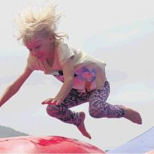 Bouncing . . . Mia Smith (then 6) plays on an inflatable at last year's gala day. PHOTOS: THE...