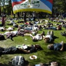 Protesters lie on the University of Otago student union lawn. Photo by Peter McIntosh.