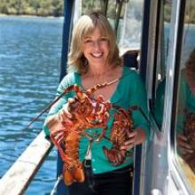Annabel Langbein with freshly caught crayfish during an episode filmed in Dusky Sound. Photo Alix Carere.