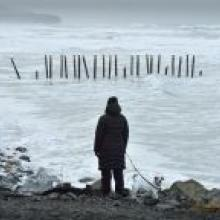 A woman scans the sea yesterday looking for Ali.