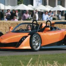 New Zealand racing driver Paul Radisich behind the wheel of the Hulme Supercar at the Goodwood...