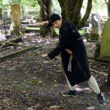 Video artist Chen Zhou poses for the camera in Dunedin's Southern Cemetery, part of the city he has visited while on residency here. Photo by Linda Robertson.