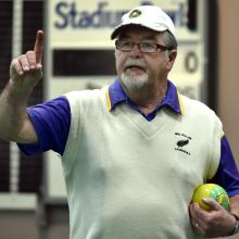 Ken Walker checks on the situation at the head during his match against fellow Dunedin bowler...