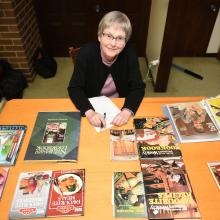 Emeritus Prof Helen Leach with some of her collection of Tui Flower recipe books. Photo: Staff...