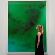 An employee poses next to 'Frieschwimmer 193' by Wolfgang Tillmans, at Sotheby's in London. Photo...