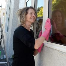 Property owner Vivienne Hagen cleans her flat in Castle St before new tenants arrive next year....