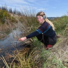 Suus Agnes Claessen listens to life in the pond. Photo: Gregor Richardson
