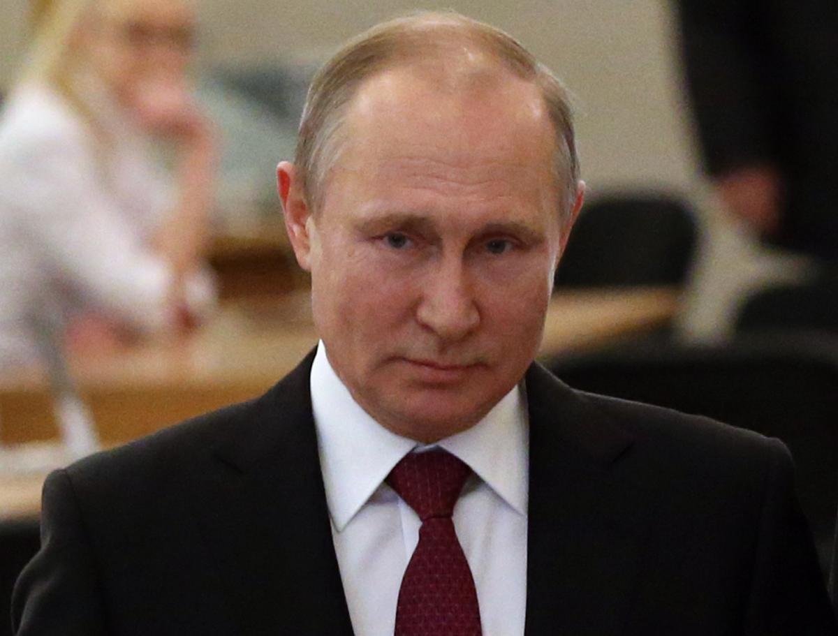 Putin wins landslide victory