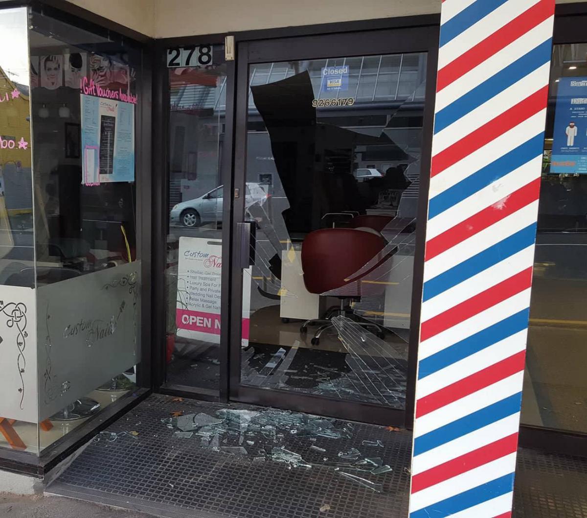 Glass door of central Dunedin shop smashed