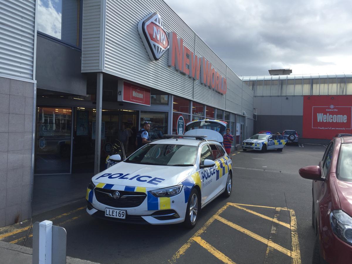 Held down after allegedly pulling knife on supermarket worker