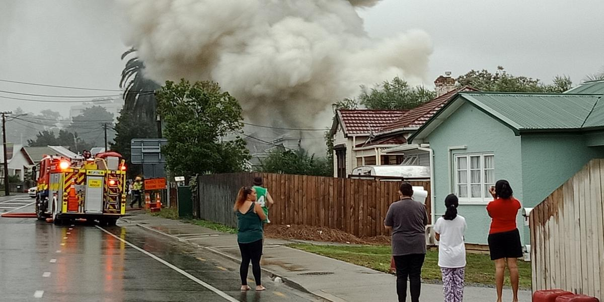 'Person running around with knife' amid house blaze
