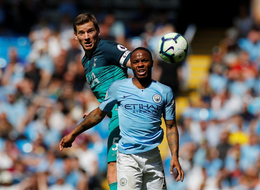 Man City go top with win over Spurs