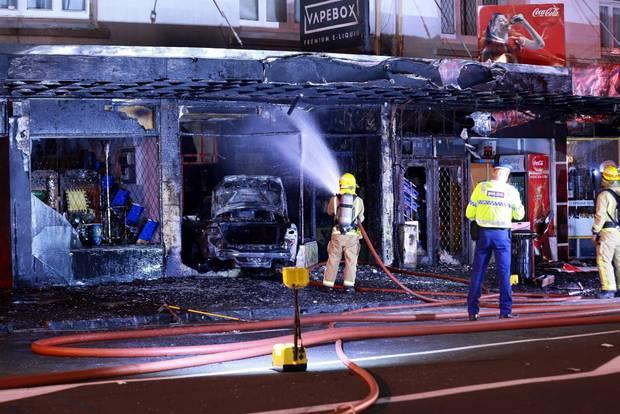 Car crashes into vape shop, burns it down