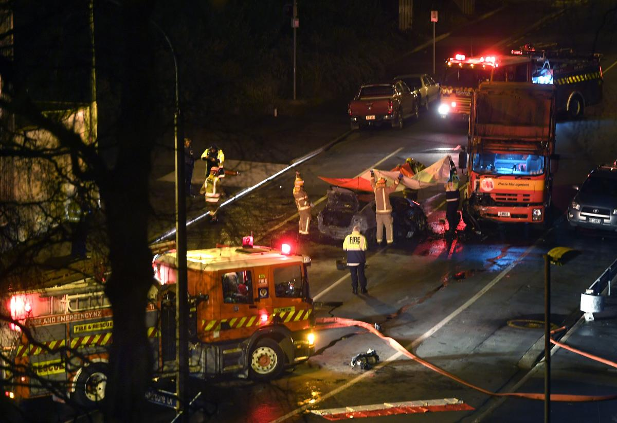 Car catches fire after crash leaving two dead in Dunedin