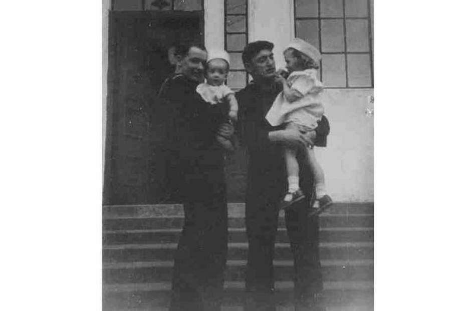 \Sailors from the picket ship USS 'Brough' hold baby Earl Winter and his cousin Diane Maharey....