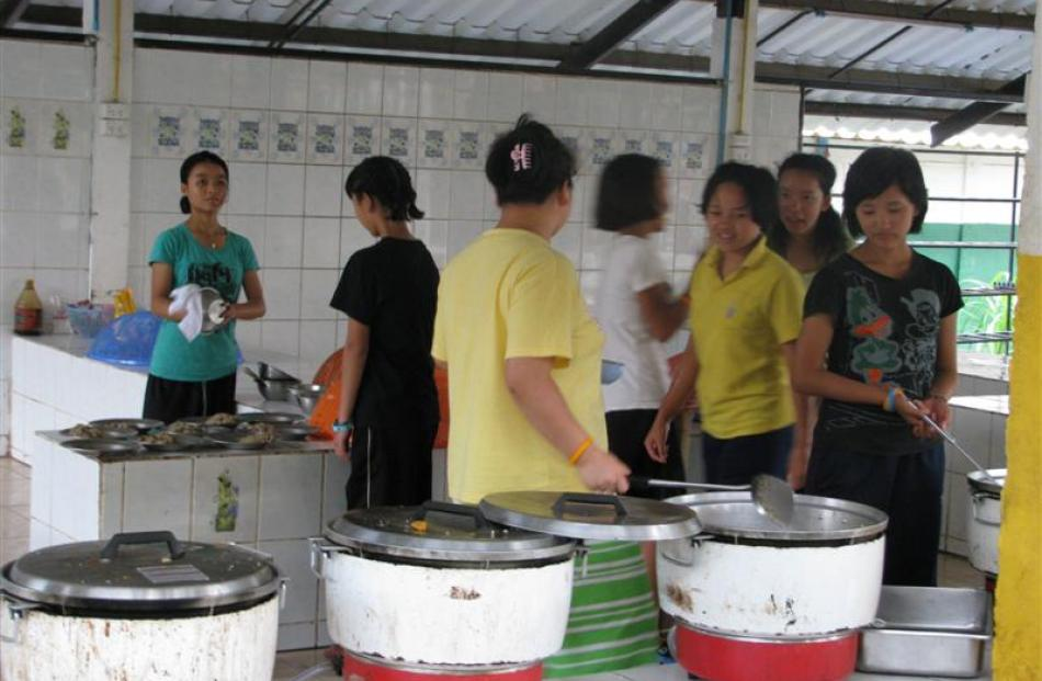 Young members of the Akha tribe in the kitchen of the rescue mission's training centre.