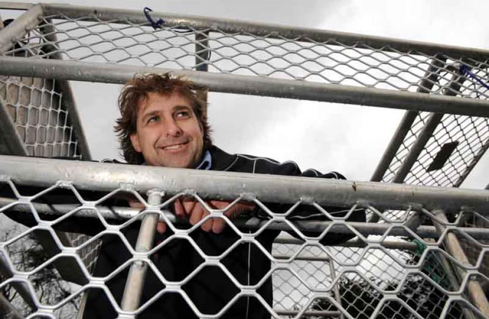Pete Dryden inside the cage from which tourists will be able to see great white sharks off...